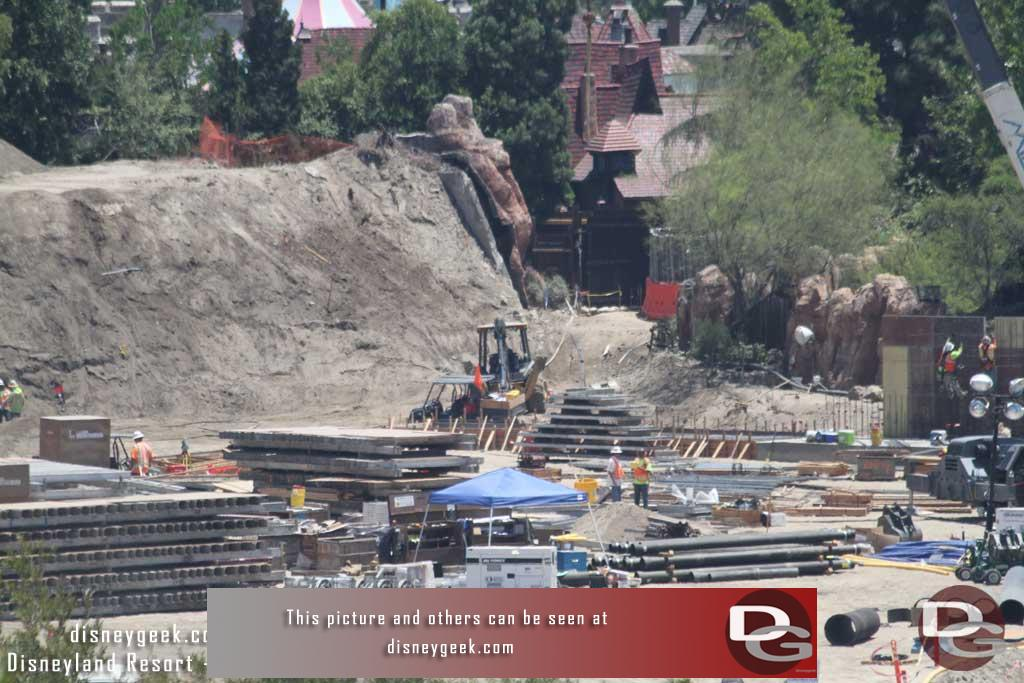7.08.16 - In the back of this picture you can see footers for the wall extending toward the Fantasyland gate.  The wall along the Big Thunder trail is taking shape.   Hopefully this will progress quickly and the trail can re-open.  It would help with flow through the park.