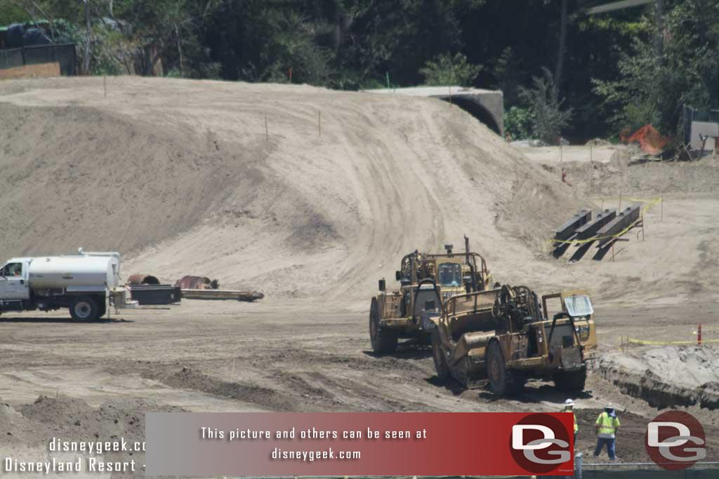 7.08.16 - There were two earth movers in action Friday.  They were taking dirt from near the big mound and bringing it to fill in a pit in the nearest area.