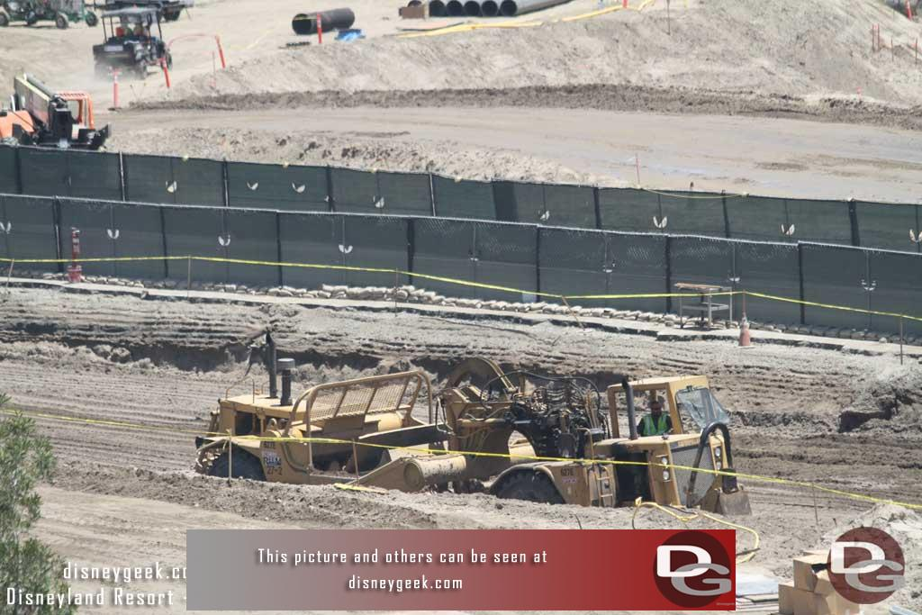 7.08.16 - Here you can see the earth mover in the pit.  It was dumping dirt.