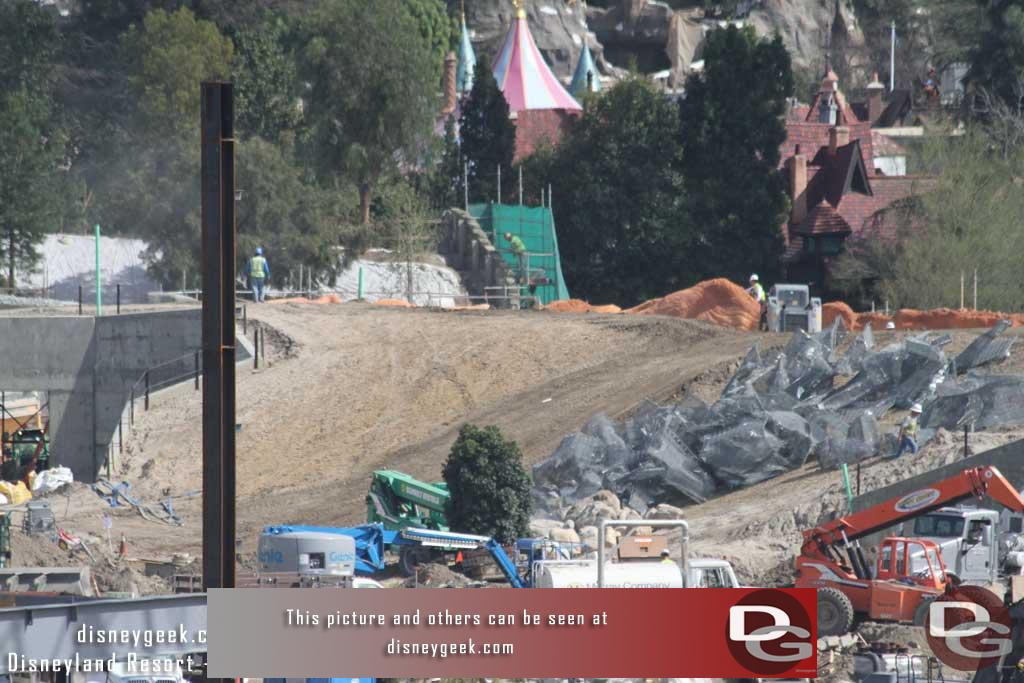 3.03.17 - Wire mesh that will be rocks is staged on the hill between the two entrances.  In the distance work on the wall facing the Big Thunder trail near Fantasyland.