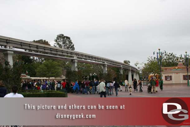 Taken - 1:58pm - The line stretched out past the monorail track (but this was off since only 4 gates were open this afternoon)