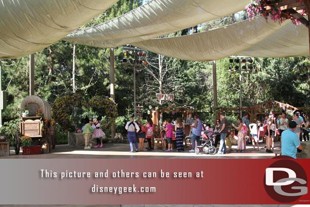 A wider picture of where Mickey and Minnie (and before them Pluto) pose for pictures.
