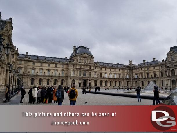 Walking into the courtyard that houses the Pyramide du Louvre