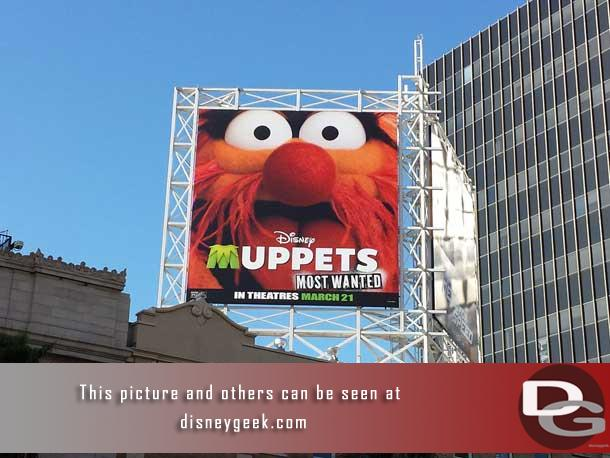 A Muppets billboard nearby.
