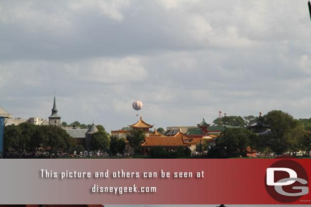 Characters in Flight Balloon at Disney Springs visible beyond China.